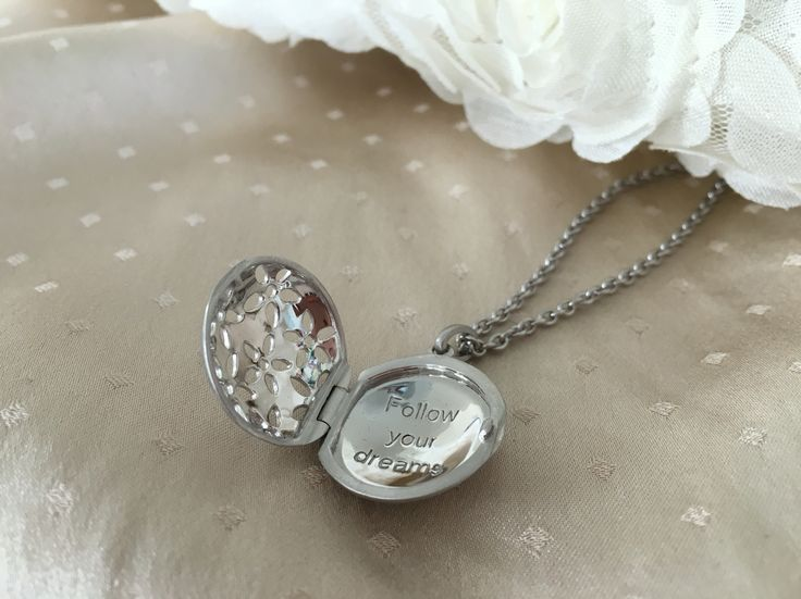 byBiehl Power Necklace. Locket with the text 'Follow your dreams'