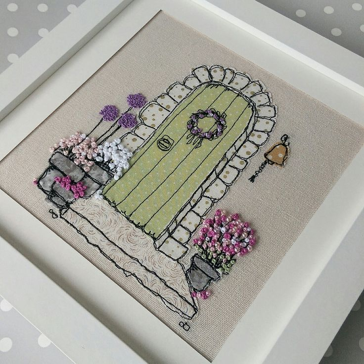 My country cottage embroidered picture. Sketched then filled in with fabric scraps secured with freemotion machine embroidery. French knot flowers added one-by-one. Perfect new home gift. Have one made from your photo for a special gift.