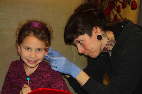 Thinking about getting your kid's ears pierced? Why a reputable tattoo parlor may be safer than using the piercing gun at the mall