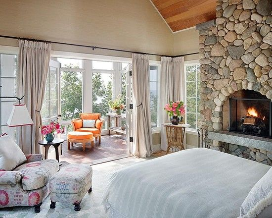 GREAT looking bedroom - with adjacent sun deck. A rustic fireplace compliments very comfortable places to sleep or sit. A truly warm and beautiful room.