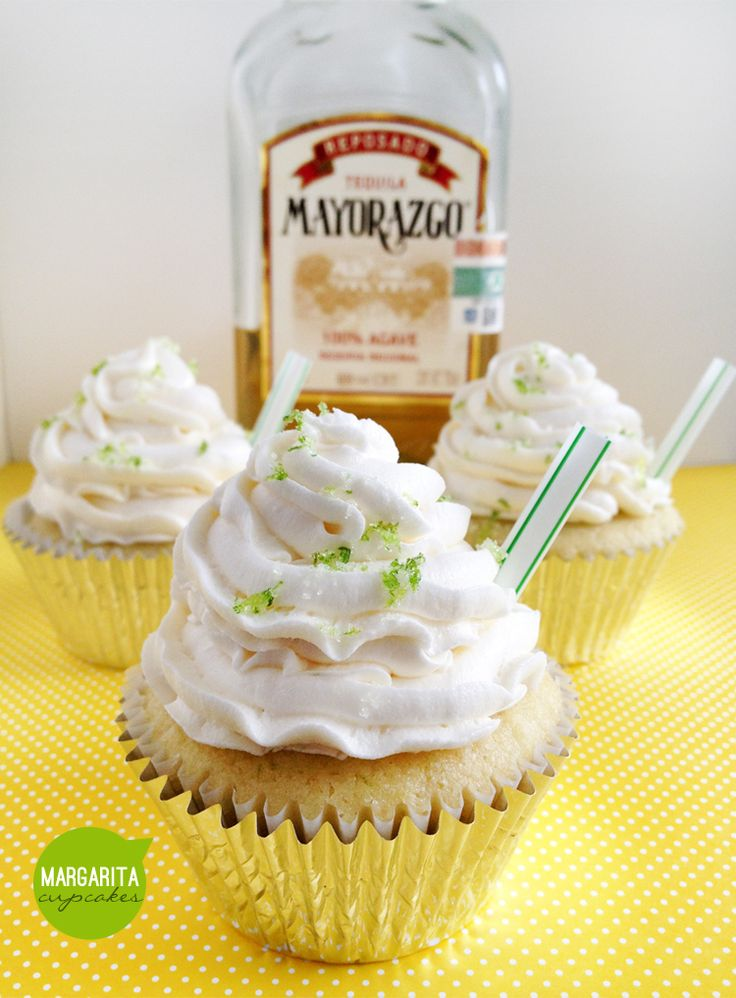 """Boozy-cakes baked with tequila, triple sec and fresh lime; topped with tequila-lime butter cream frosting and a mini straw for """"sipping""""!"""
