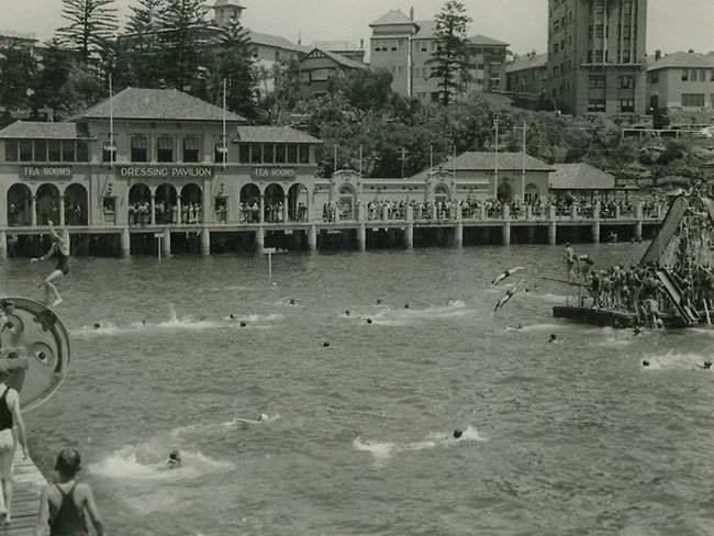 People enjoying the floating slides in the harbour pool opposite The Pavilion at Manly Cove.