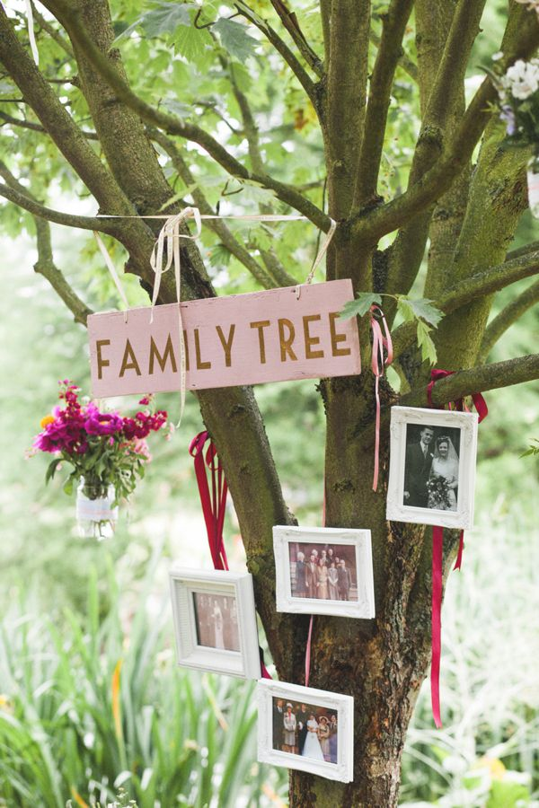 Family tree wedding photographs hanging in a tree. Beautiful wedding day styling, from 'Azalea by Jenny Packham and a Delicate Floral Crown for a Bohemian Meets Edwardian Style Wedding At Emmanuel College, Cambridge' http://www.mandjphotos.com/