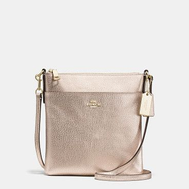 north/south swingpack by COACH. Shop The COACH North/south Swingpack In Embossed Textured Leather. Enjoy Complimentary Shipping & Returns! Find Desig...