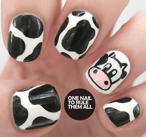 Adorable black and white COW NAILS! My boyfriend's 12 year old daughter would LOVE these!