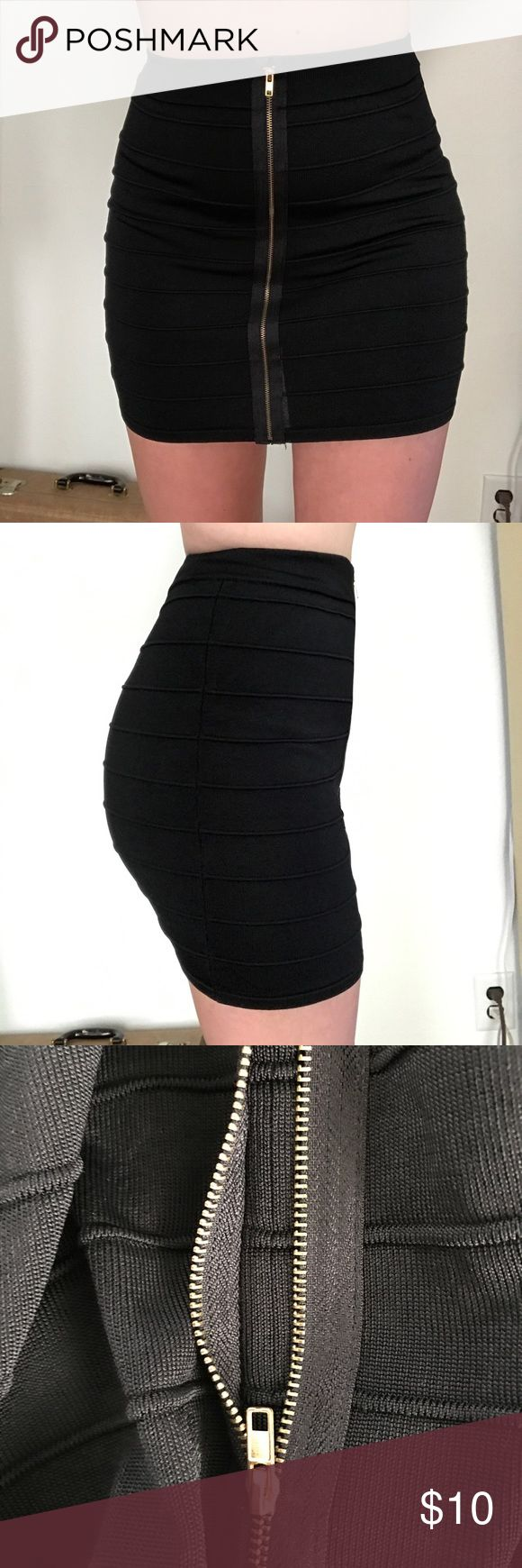 Sexy body-con skirt Tight black skirt. Has a zipper on the front but it's fake. The skirt is stretchy and easy to put on. Is a size large but could fix most sizes. Never wore Charlotte Russe Skirts Mini