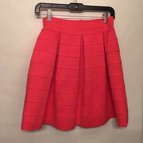 Last night! Express Pleated coral skirt Only worn twice! BEAUTIFUL pleated coral skirt with a mini scalloped hem. Could also fit a size large. Worn 2xs! Express Skirts