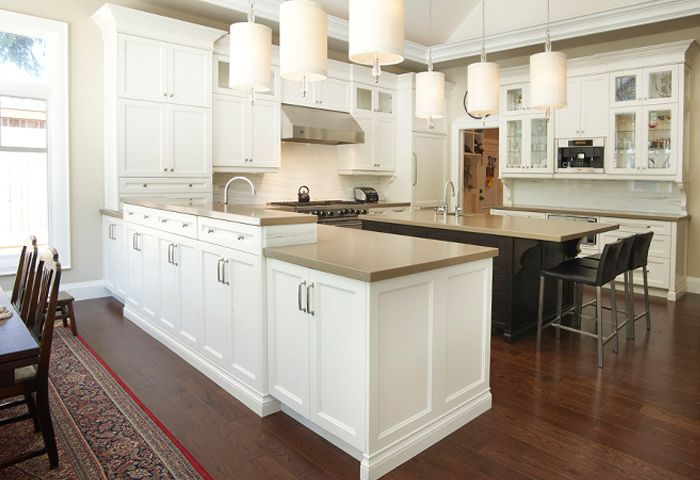 white transitional kitchen with dark island, olympic kitchens