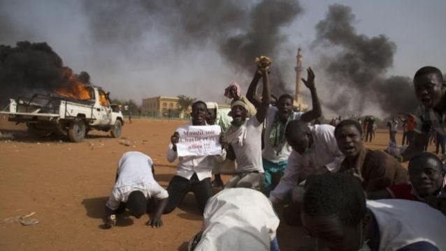 Niger rioters torch churches and attack French firms in Charlie Hebdo protest. At lease five killed as armed protesters angered by cartoon of prophet Muhammad go on rampage in capital.