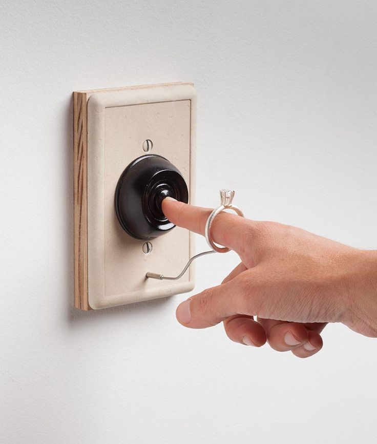 """Untitled"" by Eunji Choi. 2012. Silver, wood, ready-made doorbell."