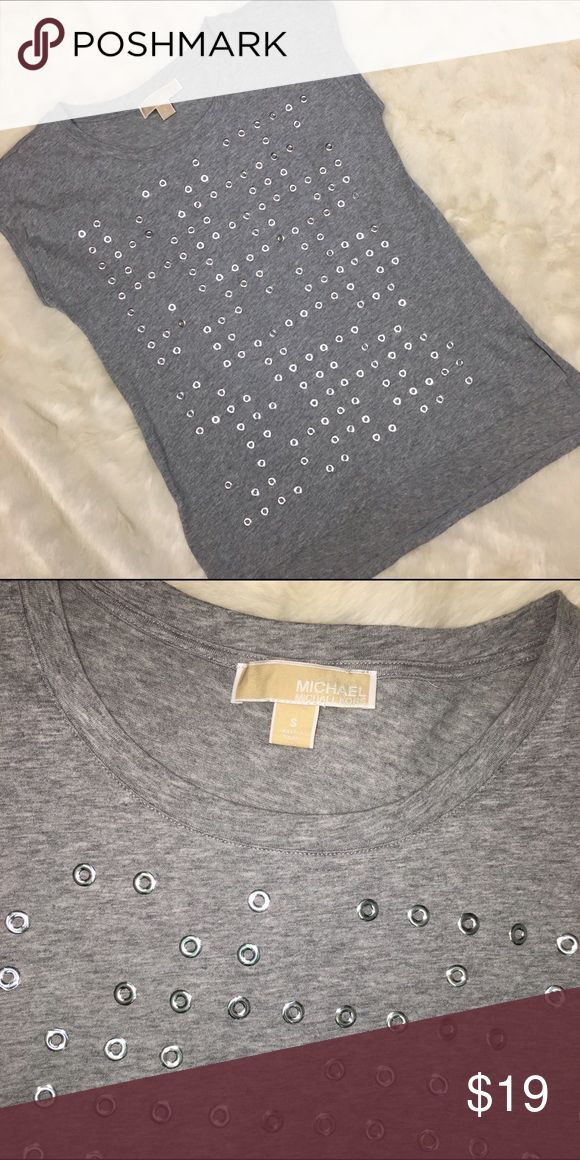Michael Kors Casual Gray and Silver Tshirt Michael Kors gray t-shirt with silver metal circles. Excellent condition and can be dressed up dressed down. MICHAEL Michael Kors Tops Tees - Short Sleeve