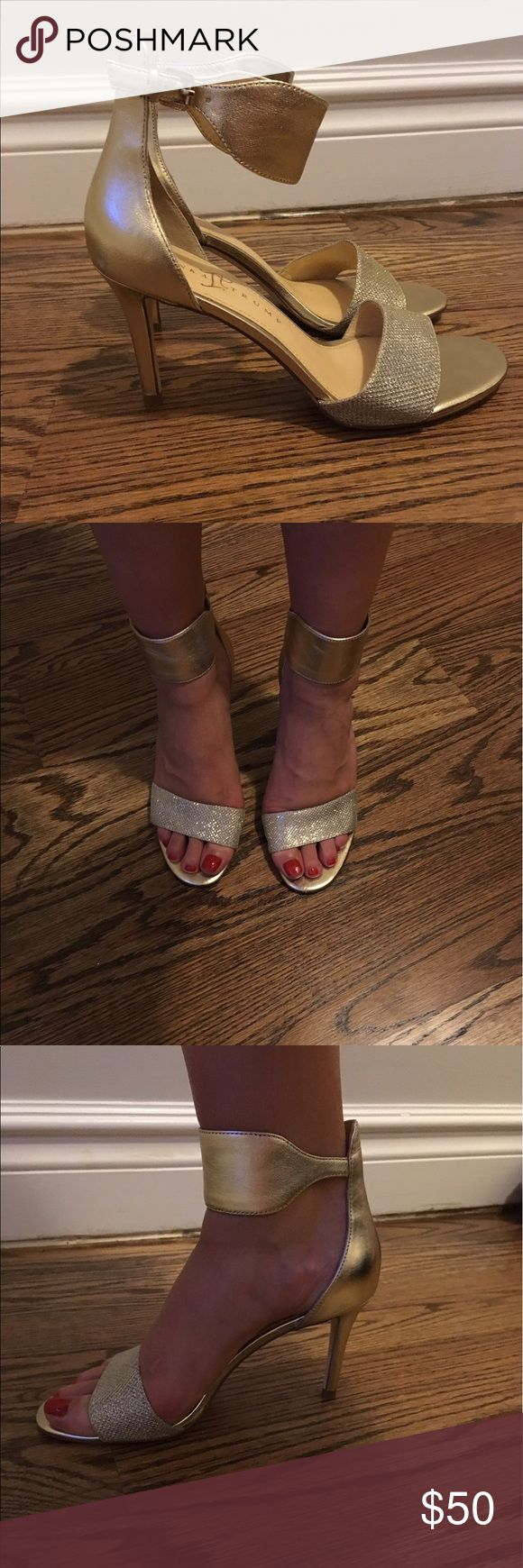 Ivanka Trump Gelana 3 gold sandal heel 7.5 Ivanka Trump Gelana 3 gold open-toe heel in size 7.5. Heel is 3.5 inches. Worn once to an event. There is a little scratch on the left shoe on the side of the ankle strap as seen in the last photo. Not noticeable when wearing. Ivanka Trump Shoes Heels