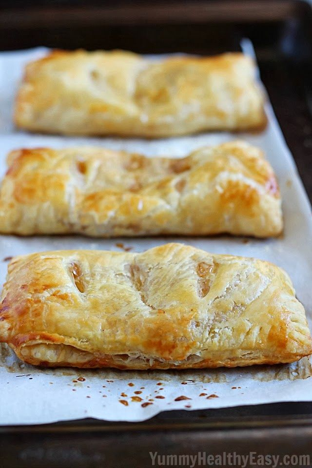 Easy Apple Hand Pies | flaky puff pastry squares filled with homemade (easy) apple pie filling. They're a simpler alternative to apple pie that you can hold in your hand!