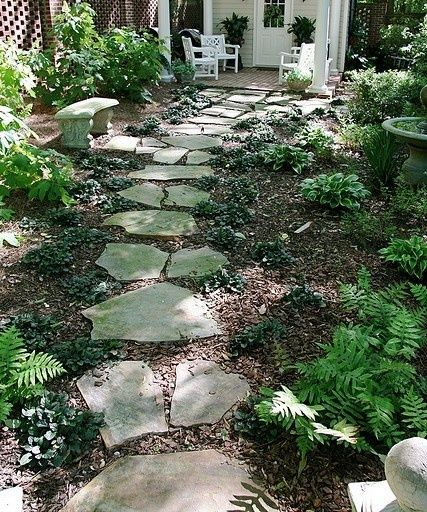 Inexpensive walkways and paths landscaping ideas on a for Landscaping ideas stone path