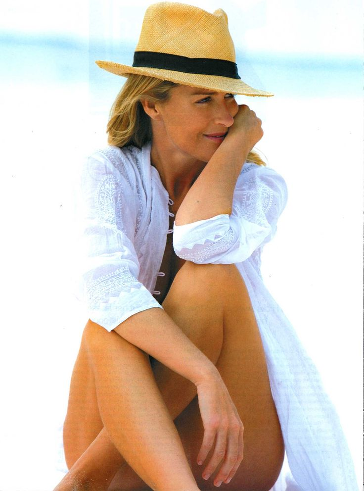 Straw hat & white shirt on white sandy beach