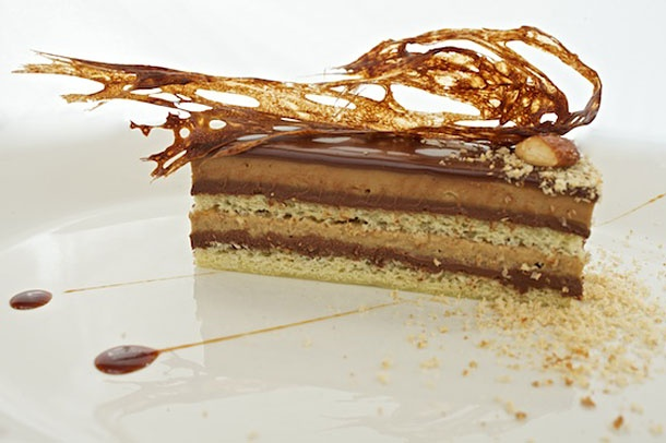 Opera Cake - layered almond jaconde sponge, caramel, caramel-espresso custard, and wafer in the middle, topped with bourbon caramel and chocolate croquant. From Absinthe in San Francisco.