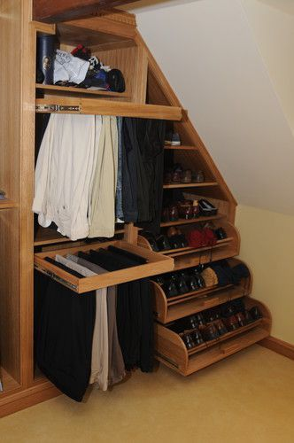 Cape second floor closet with slanted / angled ceiling...great use of short wall...love the pull out racks.