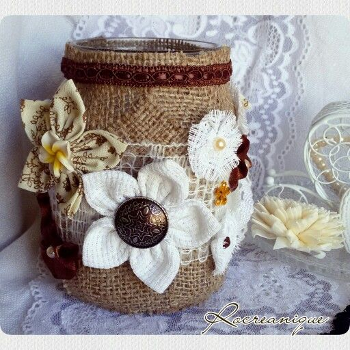 Vintage mason jar covered with burlap and decorated with flowers by Rocreanique