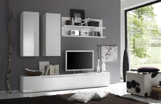 Italian contemporary entertainment center. This is a sleek and unique designed entertainment center. A sophisticated composition where each detail worth. The individual units allow to organize only those areas you want and make a huge TV area that is impossible to make with the joint wall unit compo...