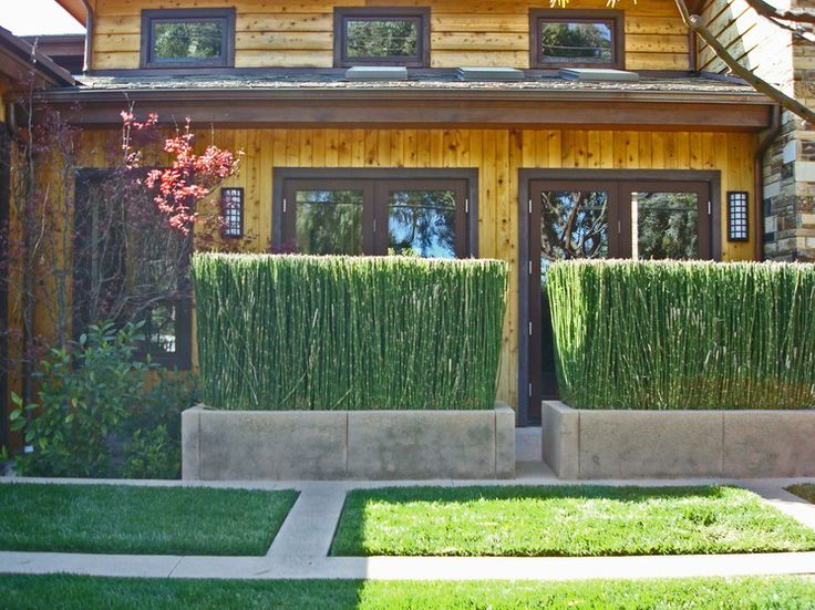 Rustic Exterior by Stephanie Ann Davis Landscape Design