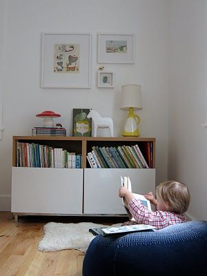 Great kids area in the living space. Think the unit is a Besta from Ikea?