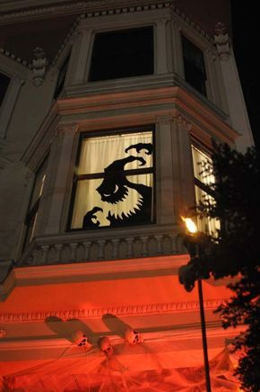 Create a scary effect on your window by drawing a Halloween mural or making a sticker.