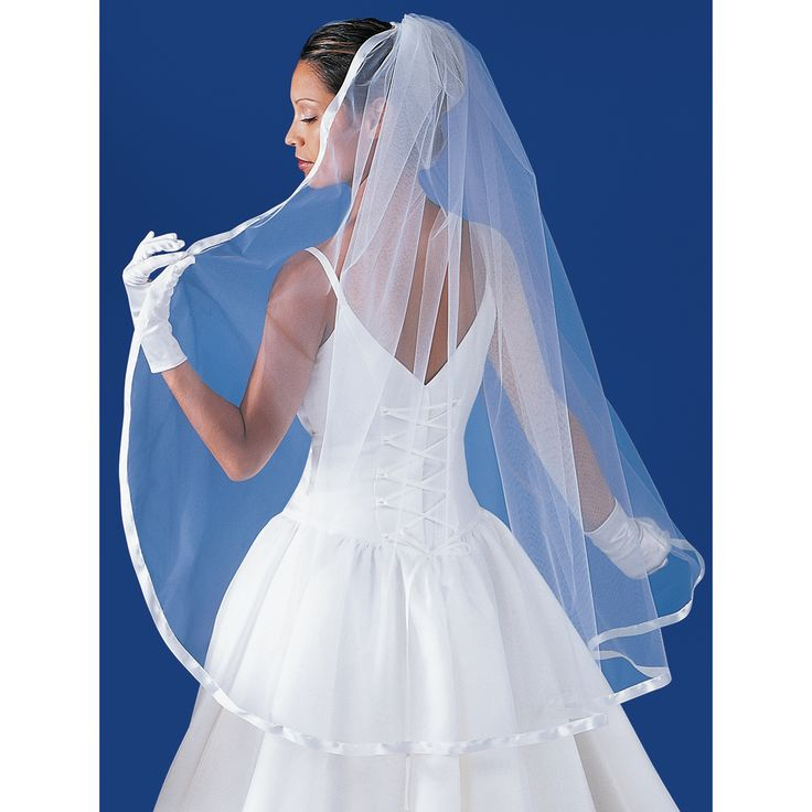 This veil is simple, yet beautiful to wear for your special day! Ribbon around the edge is 5/8 of an inch wide.