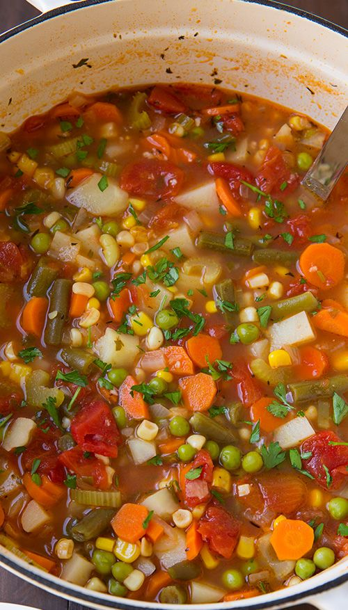Vegetable Soup - it's hearty, comforting, healthy and 100X better than the canned stuff. LOVED this soup! Corn, carrots, peas, tomatoes, and lots of other veggies!