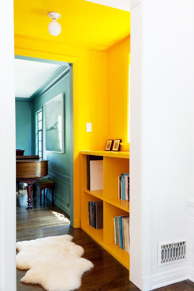 Tour a Bright, Fresh LA Family Home // teal and bright yellow, sheepskin throw rug