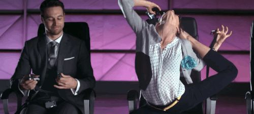 First, for the .001% of you who have never operated a seatbelt before, a contortionist demonstrates how it's done. | Virgin America Made The Most Gloriously Entertaining Airline Safety Video Ever