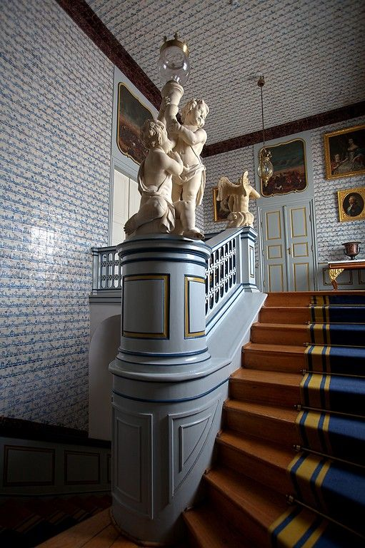 Rococo staircase of the Nieborów Palace, Poland,  was adorned with Dutch blue tiles from about 1700 made in the Harlingen manufacture for the palace's owner Michał Kazimierz Ogiński between 1766-1768; the palace is a division of the MNW