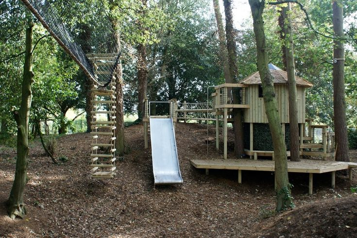 Splashy wooden playhouse in Kids Traditional with Playhouse Slide next to Outside Swing Daybed alongside Kids Rope Bridge and Tree Swing