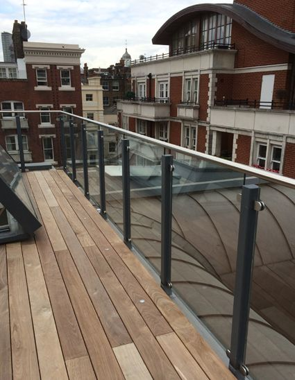 Glass balustrade offering safe, external space on this roof terrace at Exchange Court, London.