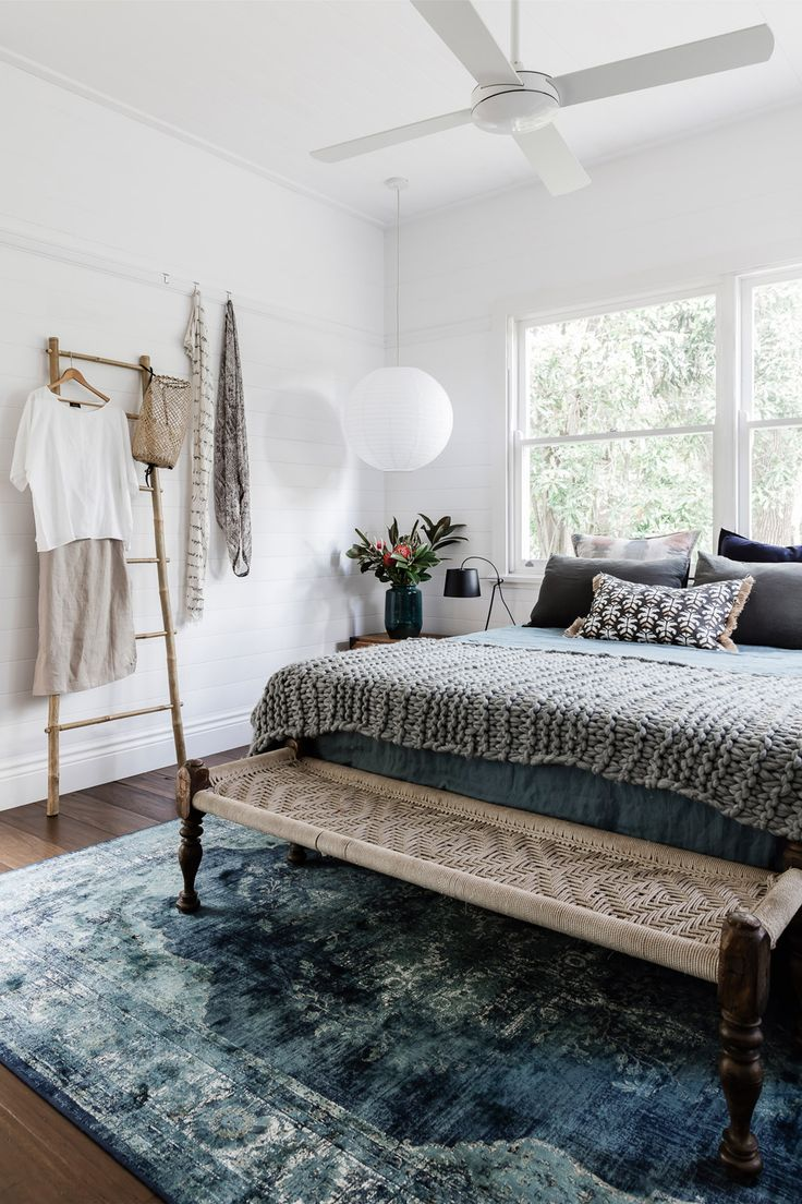perfect layers cozy up a fresh white bedroom | earthy modern house tour on coco kelley