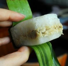 lemper ayam - Indonesian traditional snack, made from sticky rice with chicken shredded inside and wrapped by banana leaves