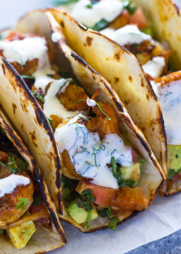 Spicy Shrimp Tacos with Avocado Salsa & Sour Cream Cilantro Sauce | Gimme Delicious