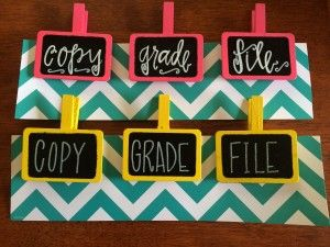 Here's a great tip to organize your classroom! Use extra pieces of border and these cute clips to keep your papers together.