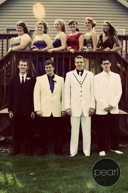 Prom poses for a large group.