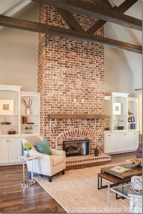 Fireplace in vaulted ceiling with wooden beams. 2015 Birmingham Parade of Homes built by Murphy Home Builders
