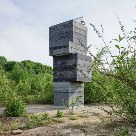 Modulorbeat stacked concrete components normally used to build mine shafts to create a tower housing a tiny sauna on the outskirts of the city of Bochum..