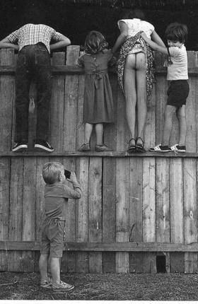 """""""Perving"""" was invented by the young Master Perving in 1951 seen here snapping a photo of unknown girl."""