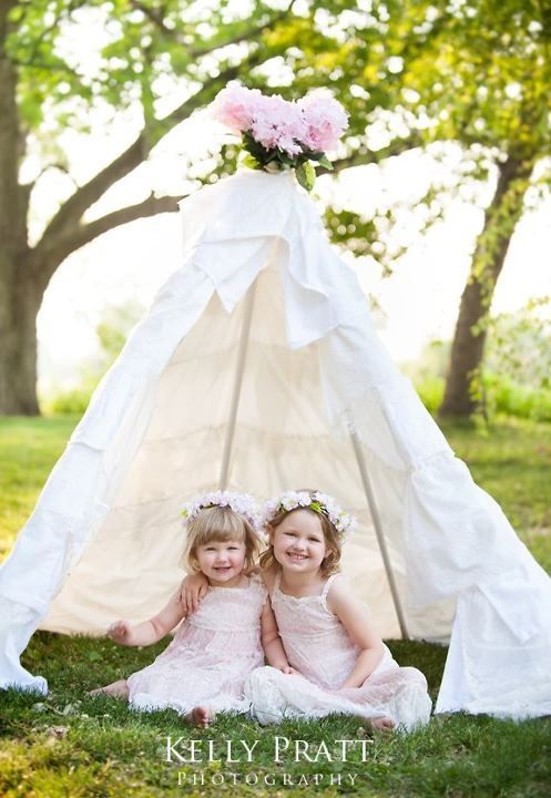 Teepee tent I made for our family photo session.  Kelly Pratt Photography took a beautiful photo - thank you!  The Train to Crazy tutorial inspired the tent!