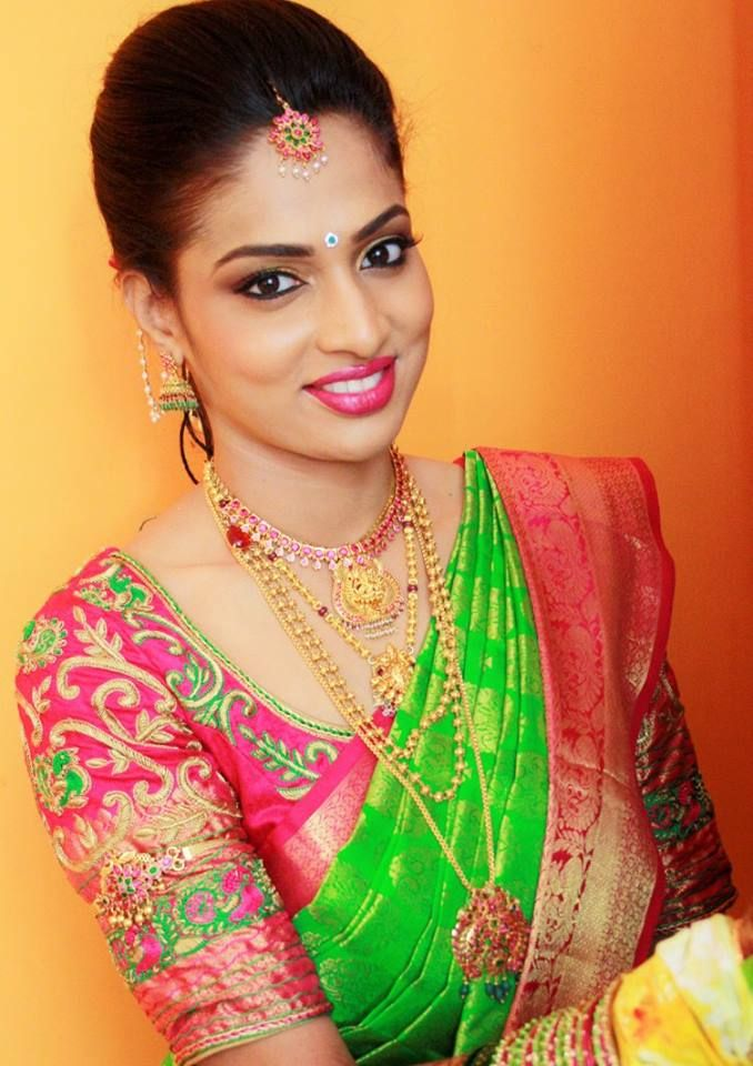 South Indian bride. Gold Indian bridal jewelry.Temple jewelry. Jhumkis. Green and pink silk kanchipuram sari.Braid with fresh jasmine flowers. Tamil bride. Telugu bride. Kannada bride. Hindu bride. Malayalee bride.Kerala bride.South Indian wedding. Makeup by Preeya (Bangalore)