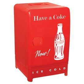 """Mini fridge with Coca-Cola lettering and lightweight design.  Product: RefrigeratorConstruction Material: Metal Color: RedFeatures:   Handle on top of unit  Self-locking door handle Holds (17) 12 ounce cansRemovable sliding shelf Thermoelectric cooling requires no ice Dimensions: 20.6"""" H x 14.8"""" W x 14.8"""" D"""
