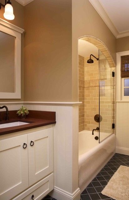 Tasteful tub and shower combo - love the arched wall and cute tiles