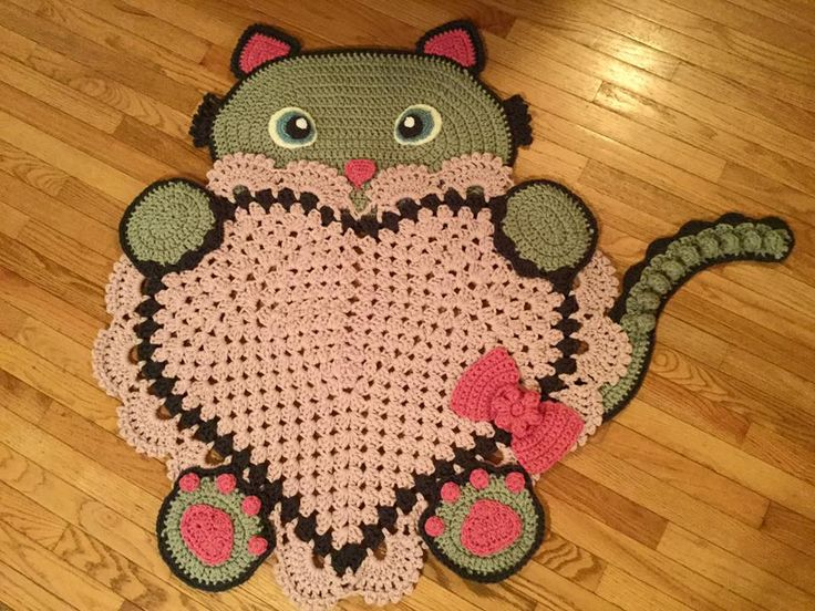 Sassy the Kitty Heart Rug by Fiber Moon Crochet can be purchased from --> https://www.etsy.com/listing/497935116/ready-to-ship-sassy-the-kitty-cat-rug  Crochet Pattern from --> https://irarott.com/Kitty_Cat_Heart_Rug_Crochet_Pattern.html