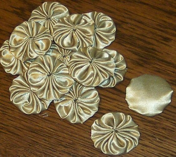 30 Gold Satin Look Yo Yo By ChaptersUnlimited on Etsy, $7.50. Alternate front and back when stitching together for a garland.