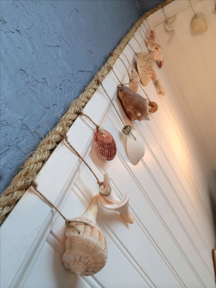 A beachy garland with shells from the beach and sisal rope (from local hardware store for around $8.00). Cheap and easy DIY project!