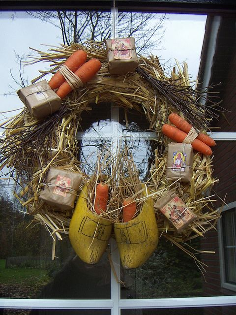 Love this wreath. Dutch shoes, carrots, and, brown paper parcels