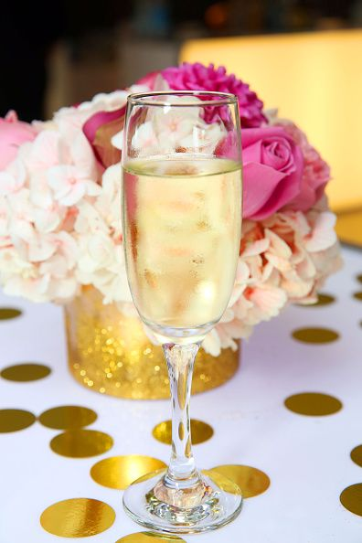 """The best tips and tricks to throw your best summer party yet: """"Beautiful flowers add charm to your soiree. Try bringing the outdoors in."""" Try bright flower arrangement centerpieces for summer."""